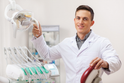 Cheerful male dentist smiling