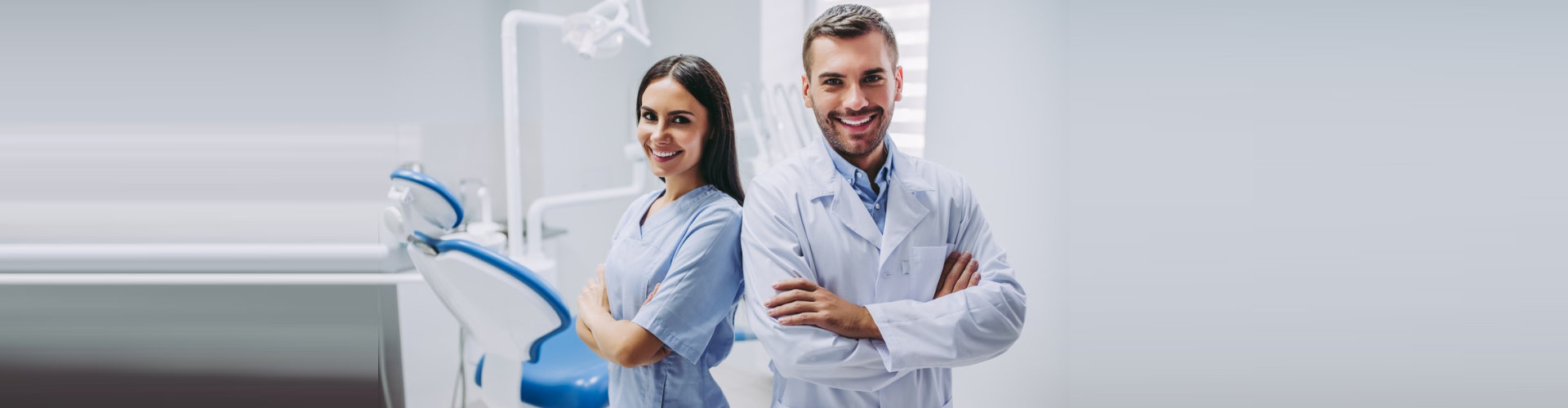 smiling doctor and assistant with crossed hands